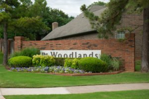 Entrance sign to The Woodlands neighborhood in Edmond, Oklahoma