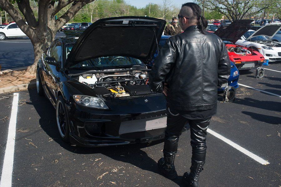 Leather boots and a mohawk to go with his Mazda.