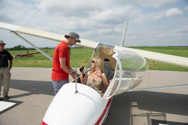 Kay is in the cockpit of a glider at Hinton Airport, getting ready for launch.