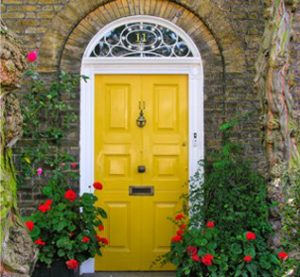 Paint your front door a glossy bright color to brighten up your entrance.
