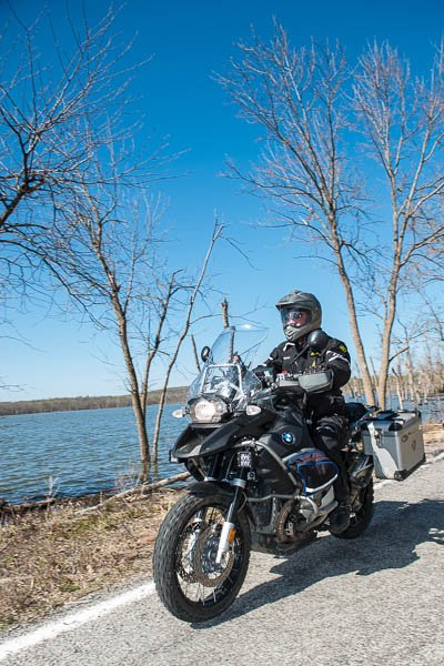 Bill Dragoo rides his BMW motorcycle along the shores of Fort Gibson Lake.