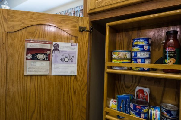 Here is an example of how to place the picture inside one of your kitchen cabinets.