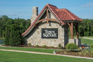 Front entrance sign for Town Square neighborhood in Edmond featuring homes built by McCaleb Homes.