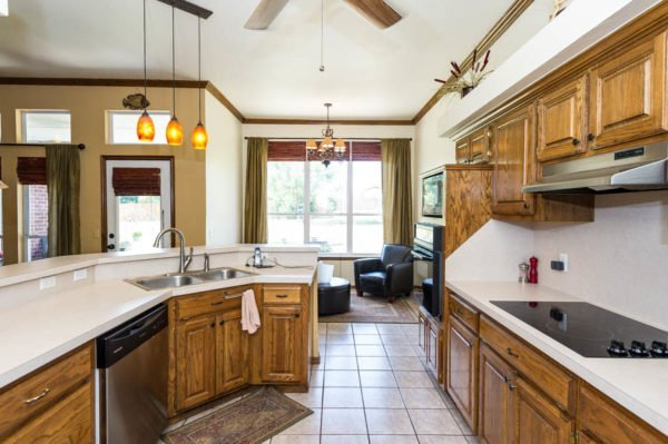 You will be able to cook in the kitchen while watching the kids play in the back yard at this home in Oak Tree Estates.