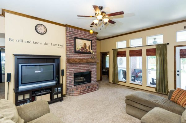An open floor plan allows the parents to enjoy time in the living room while watching the kids play in the back yard of this home in Oak Tree Estates.