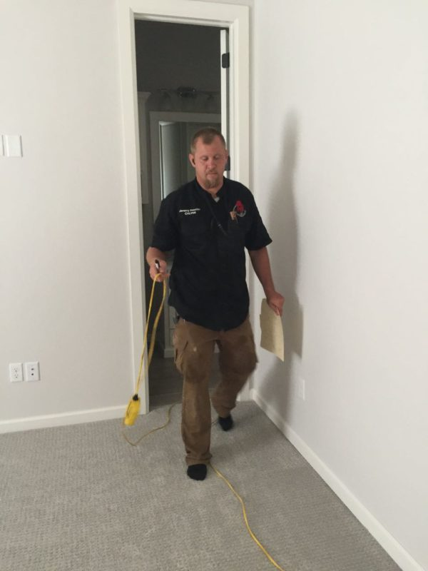 Home inspector with foundation level probe
