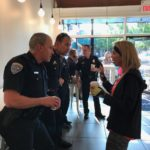 "Kay talks to Edmond Police patrol officers at ""Cops and Coffee"" meeting at Evoke Coffee in downtown Edmond."