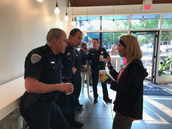 """Kay talks to Edmond Police patrol officers at """"Cops and Coffee"""" meeting at Evoke Coffee in downtown Edmond."""